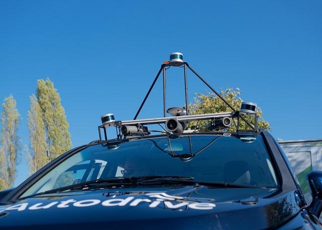 Roof-mounted sensors on the autonomous vehicle.