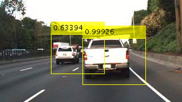 Photo from a vehicle camera showing two other vehicles detected.